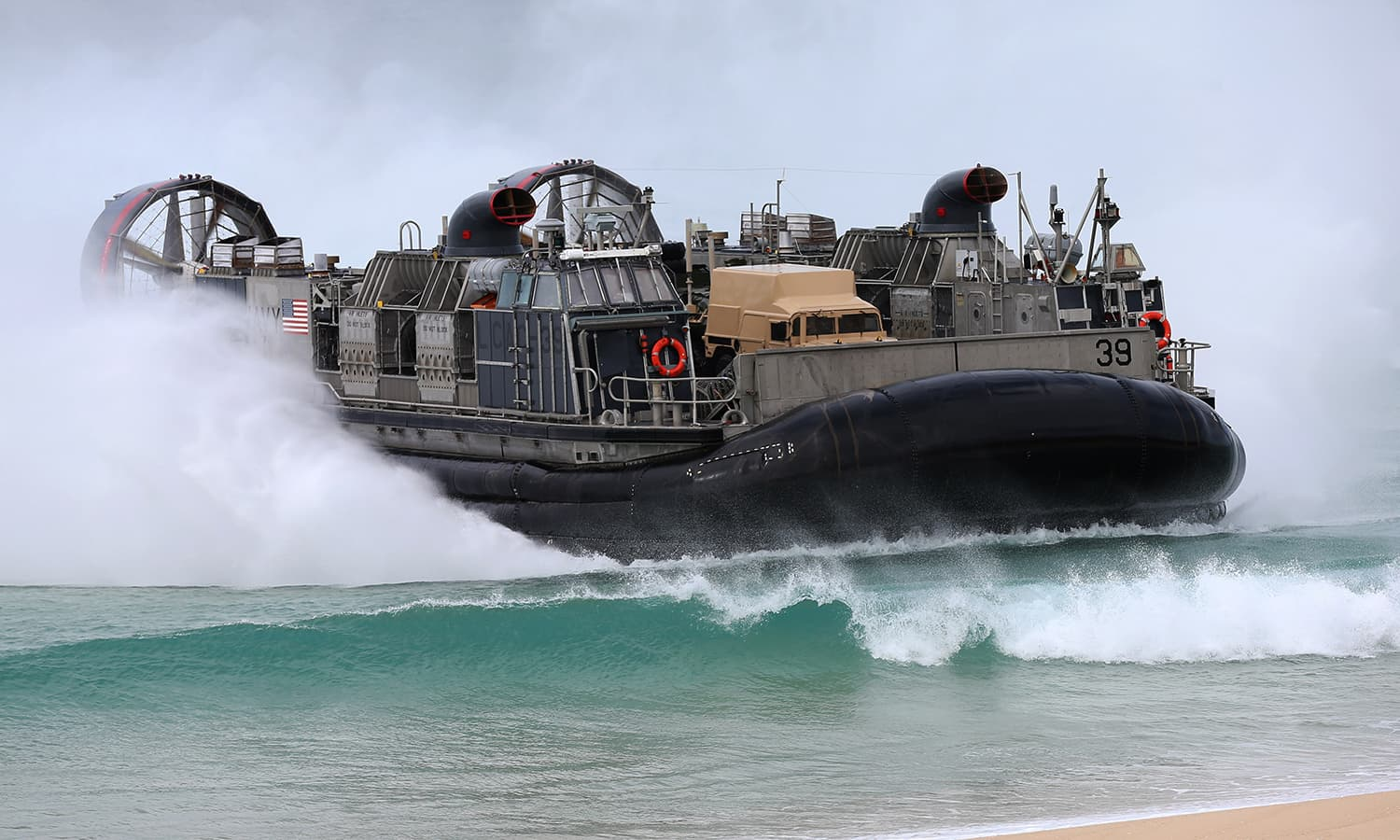 A US Navy hovercraft approaches the beach at the beginning of the Nato Trident Juncture exercise 2015 at Raposa Media beach in Pinheiro da Cruz, south of Lisbon. — AP