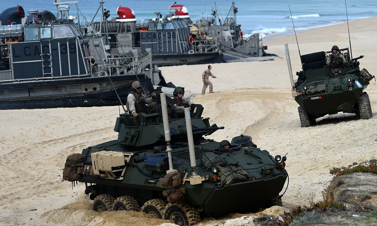 US marines disembark their armoured vehicles from the hovercrafts deployed by the USS Arlington amphibious transport dock during the Nato's Trident Juncture exercise. — AFP