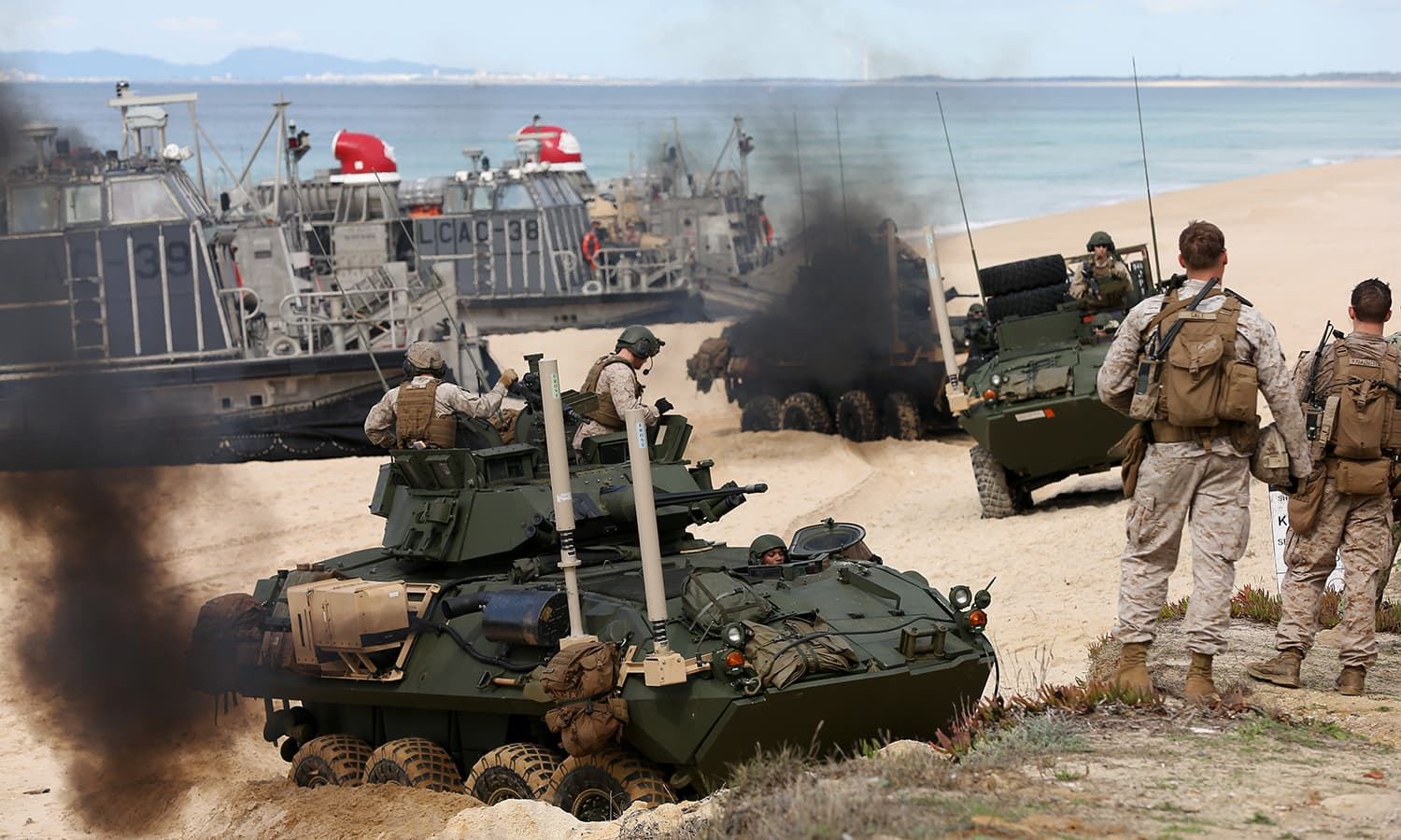 US marine armoured vehicles steers through the soft sand after getting off from a US Navy hovercraft — AP