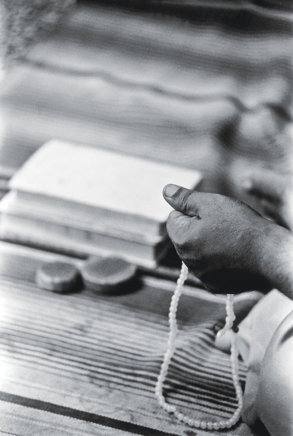 A man prays at an imambargah in Kharadar, Karachi   Arif Mahmood, White Star