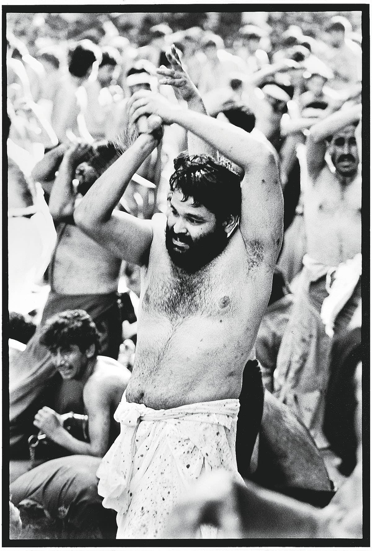 A man flagellating at a Muharram procession in Kharadar, Karachi   Arif Mahmood, White Star