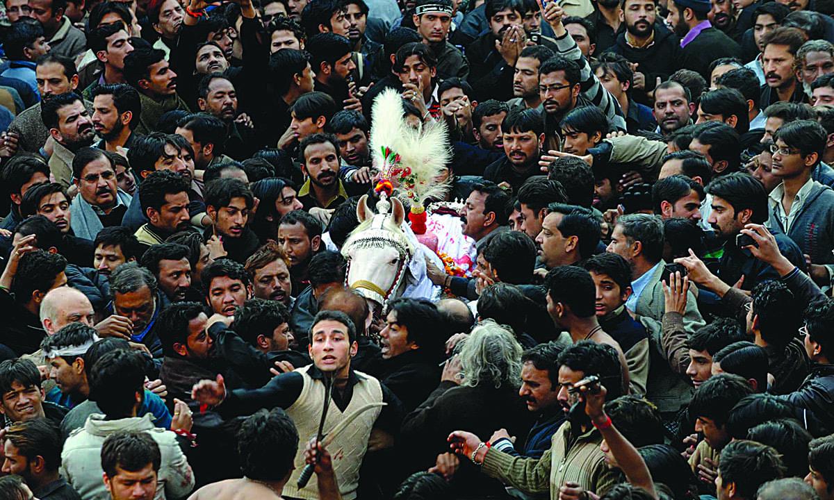 Mourners at a Muharram procession near Nisar Haveli, Lahore   M Arif, White Star