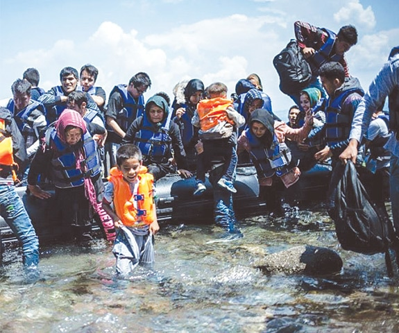 Refugees getting off the boat after landing at Kos, Greece