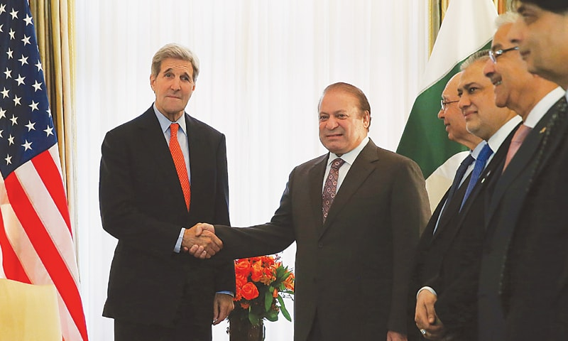 US Secretary of State John Kerry meets Prime Minister Nawaz Sharif in Washington on Wednesday.—AFP
