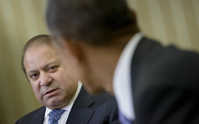 US President Barack Obama (R) listens to Pakistan's Prime Minister Nawaz Sharif make a statement to the press before a meeting in the Oval Office of the White House October 22, 2015 in Washington, DC. —AFP