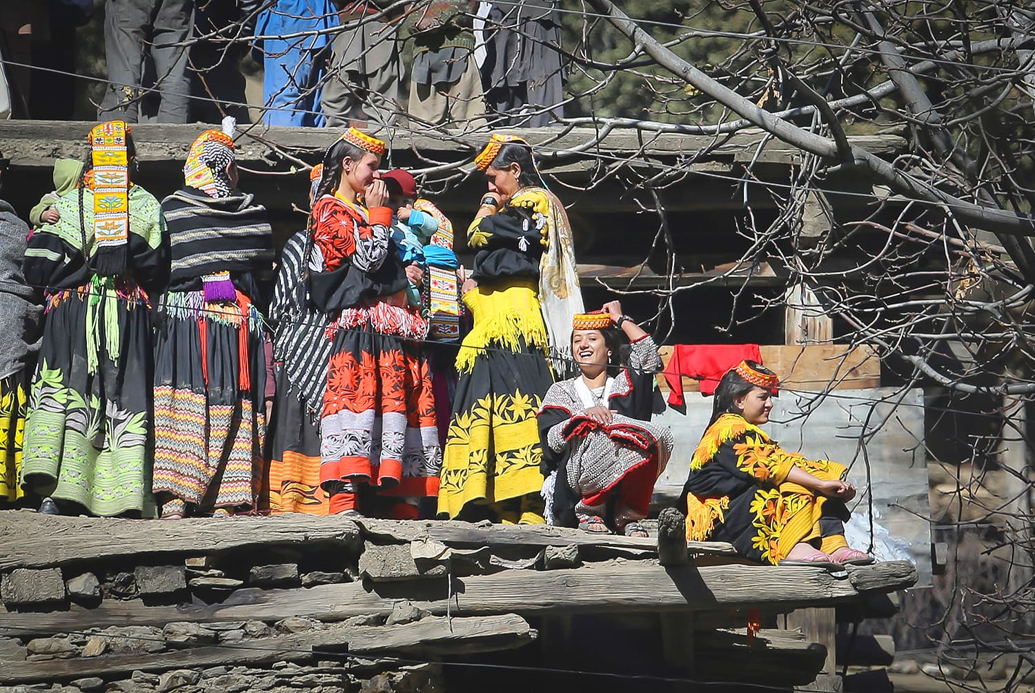 Kalash women dressed in colourful dresses.