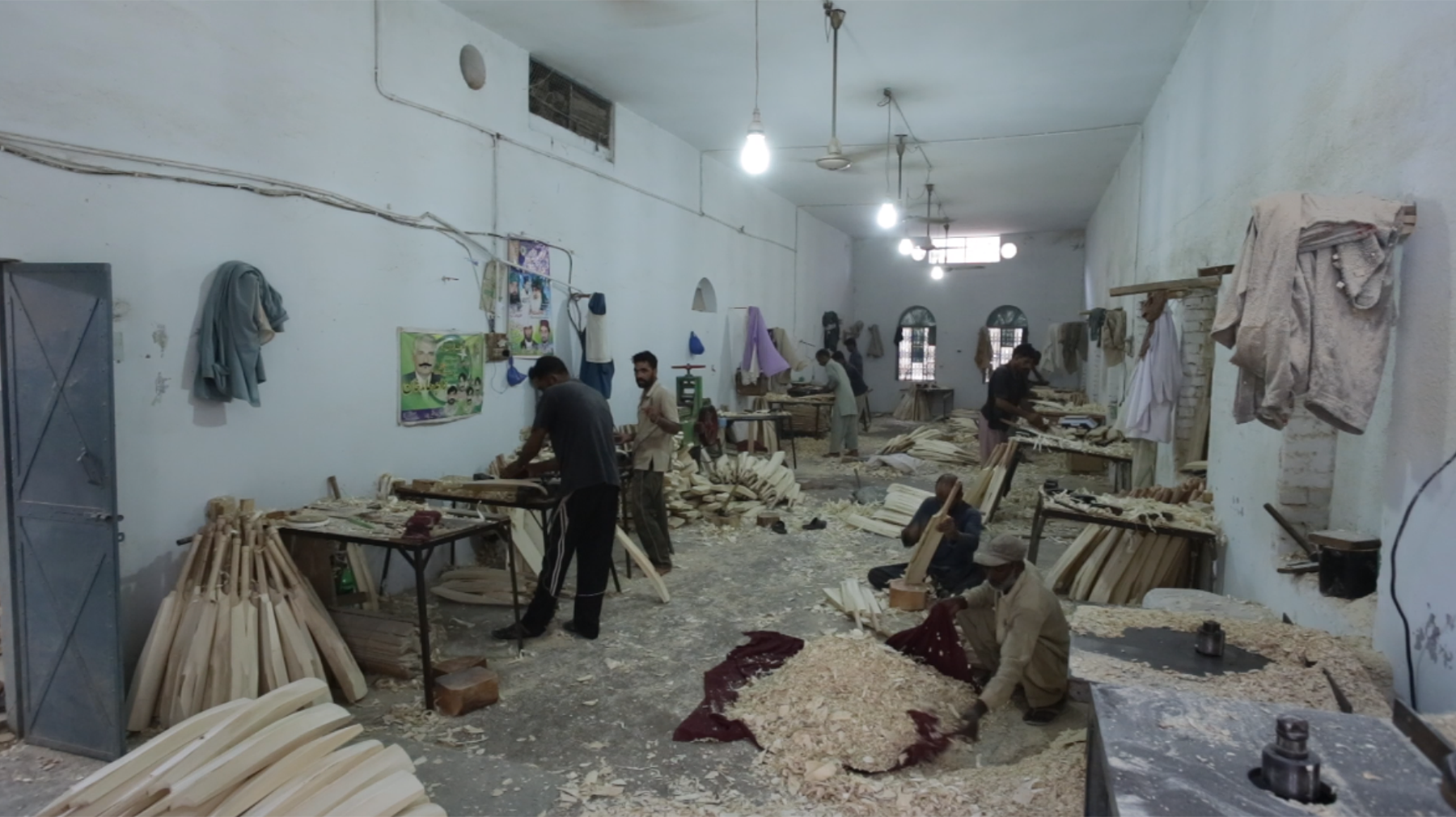 Workers busy carrying out their individual tasks inside the factory.