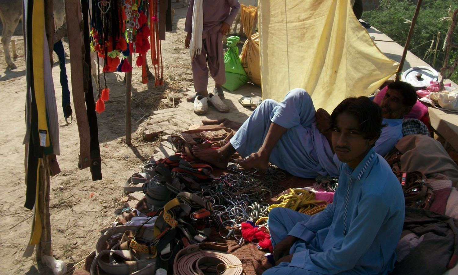 Donkey ornaments - Stall Owners Waiting To Sell Ornaments And Donkey Accessories At The Annual Donkey Market In Badin