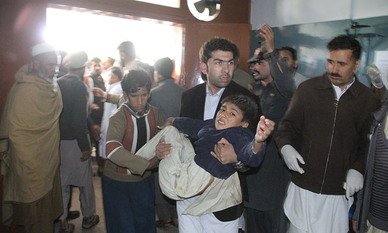 A man transfers an injured minor to a hospital in Swat. – Fazal Khaliq