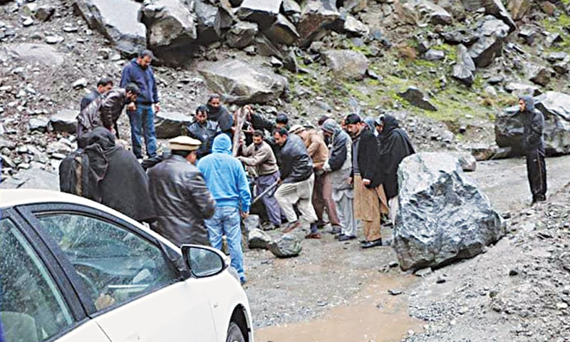 Karakoram Highway: People remove boulders blocking the Karakoram Highway in Kohistan after a landslide caused by the earthquake.—Hussain Nagri