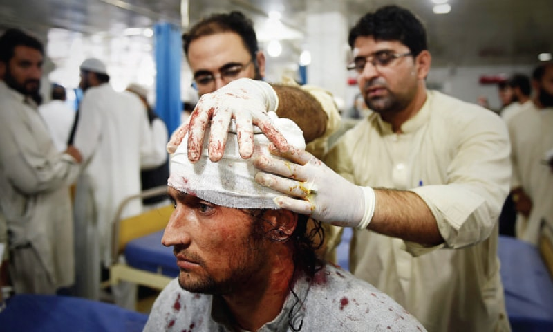An injured man being given first aid at Lady Reading Hospital, Peshawar on Monday. — White Star
