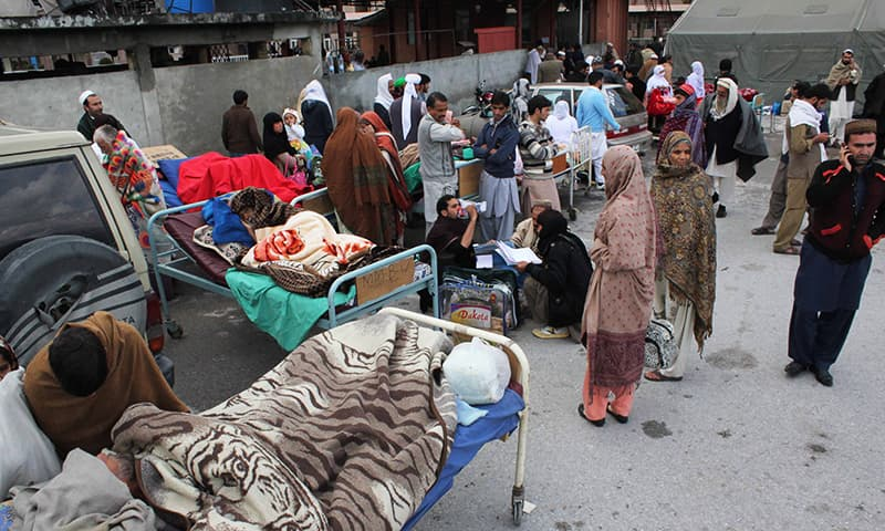 People injured from an earthquake receive treatment outside the Ayub Medical Hospital in Abbotabad, Pakistan, Monday, Oct. 26, 2015. —AP