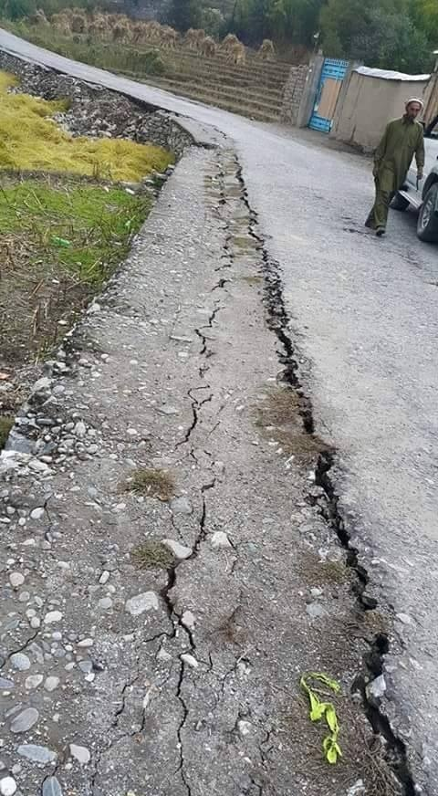 A road damaged due to the earthquake in Chitral. —DawnNews