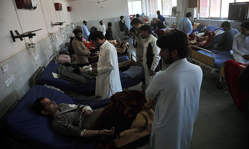 Injured Pakistanis are treated in a hospital following an earthquake in Peshawar on October 27, 2015. —AFP