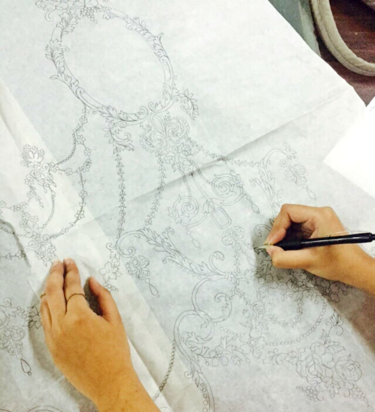 A designer at Maria B works on the embroidery sketch - Photo courtesy Maria B