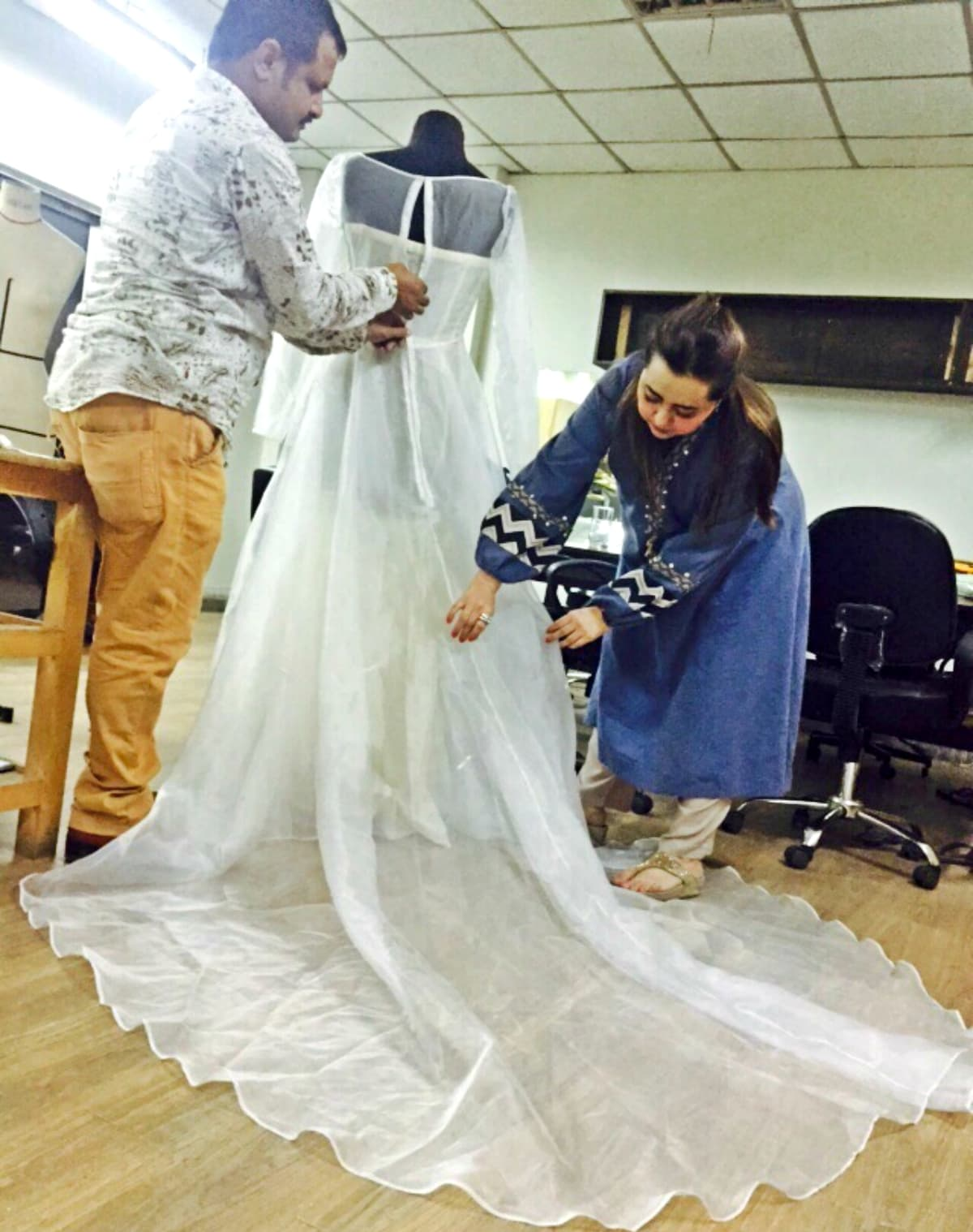 Maria B looks over her design in creation – Photo courtesy Maria B
