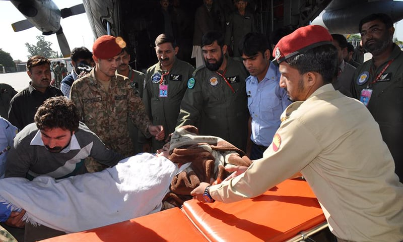 Injured are shifted to an army aircraft for further treatment at CMH. -Photo courtesy Pakistan Army