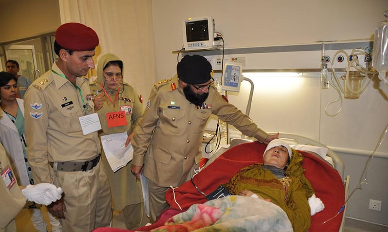 Army doctors check on injured at CMH. -Photo courtesy Pakistan Army