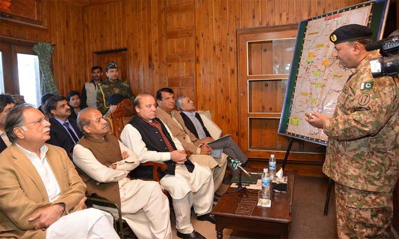 PM Nawaz attending a briefing about damages caused by earthquake in Shangla on October 27- photo PID