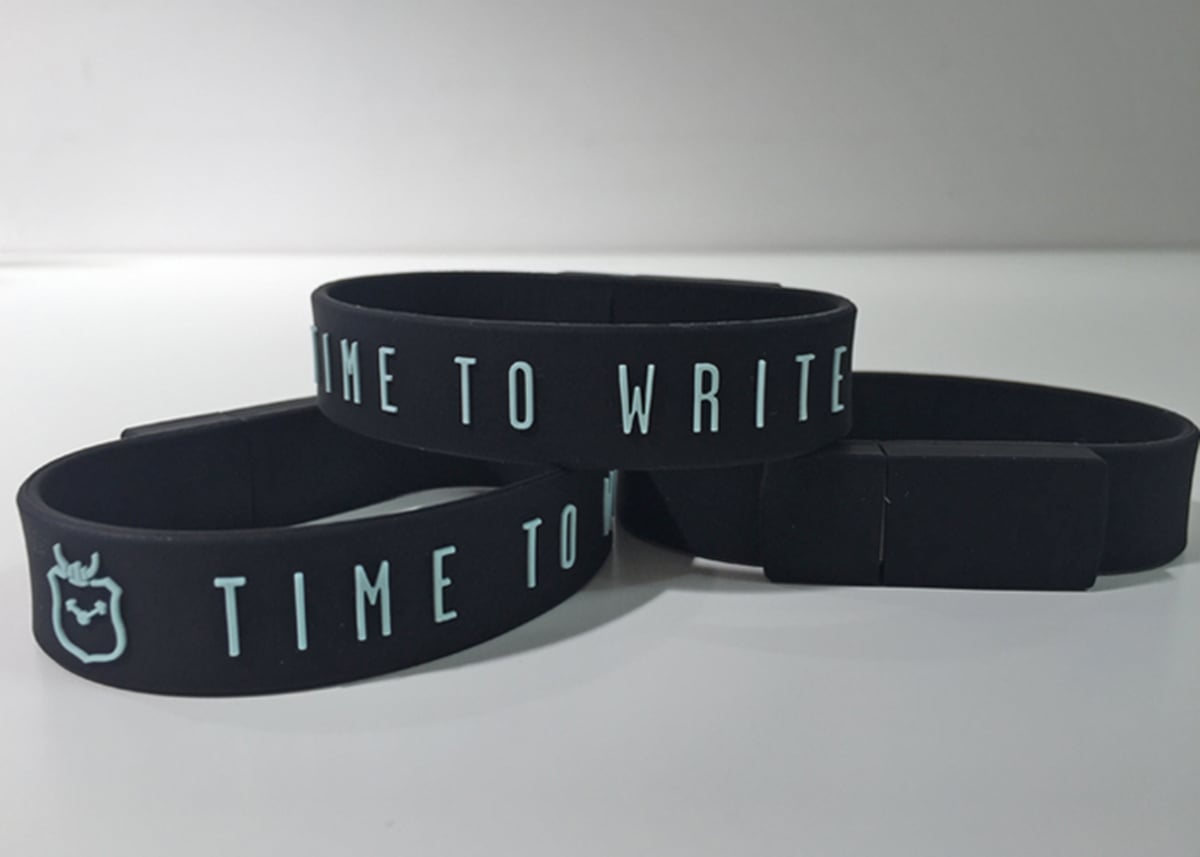 These USB  bracelets are a part of official NaNoWriMo merchandise because you never know when you gotta save that story. Hoping to see them here too!