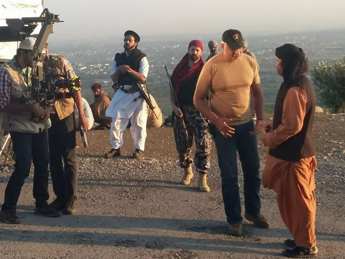 The director has a few words with veteran actor Ayub Khoso