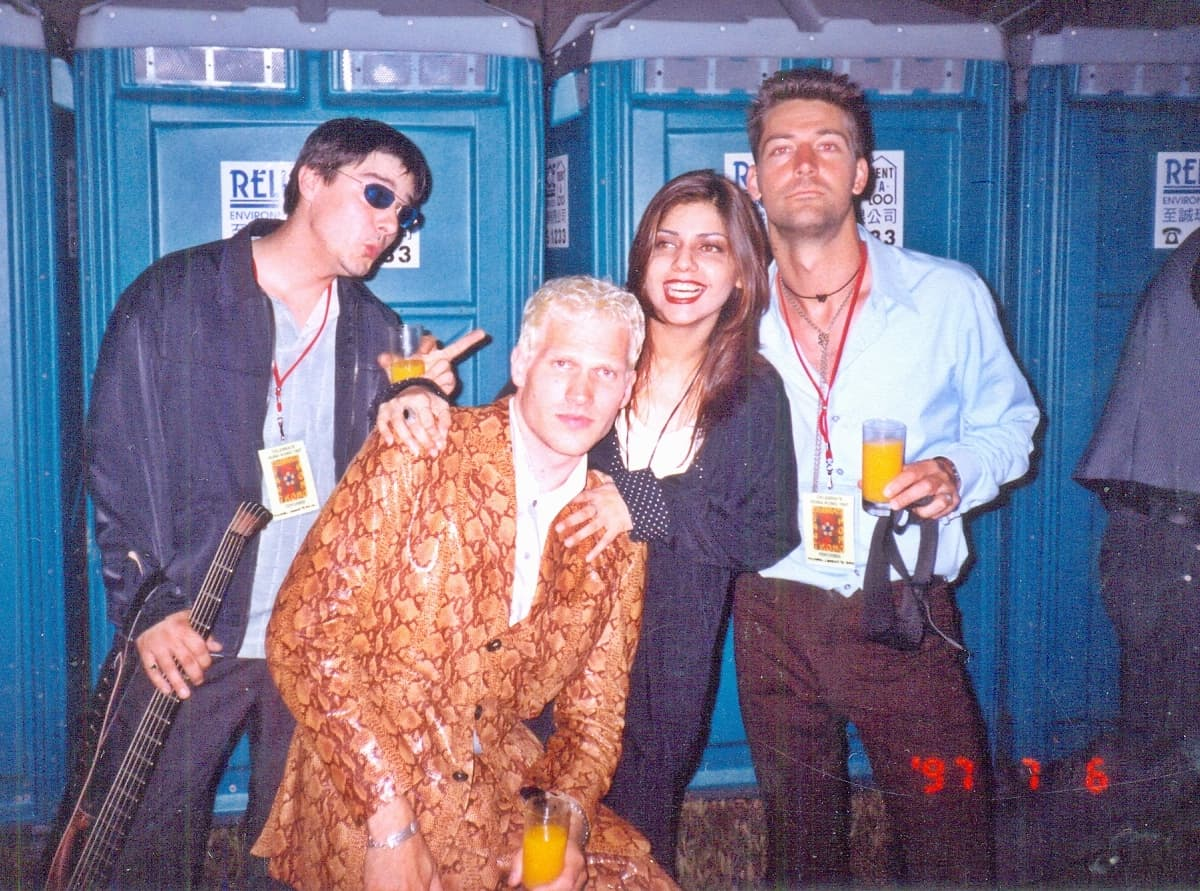 Here she is chilling with Danish boy band Michael Learns To Rock in Hong Kong