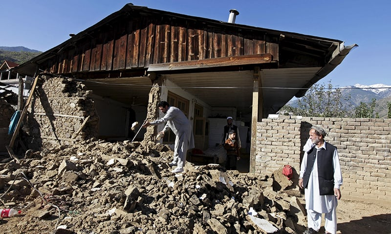 A man clears the rubble of the house of 50-year-old herbal healer Najib Alam, whose mud-and-stone house was damaged by the 7.5 magnitude quake, in Rehankot village in District Dir, Pakistan, October 28, 2015— Reuters