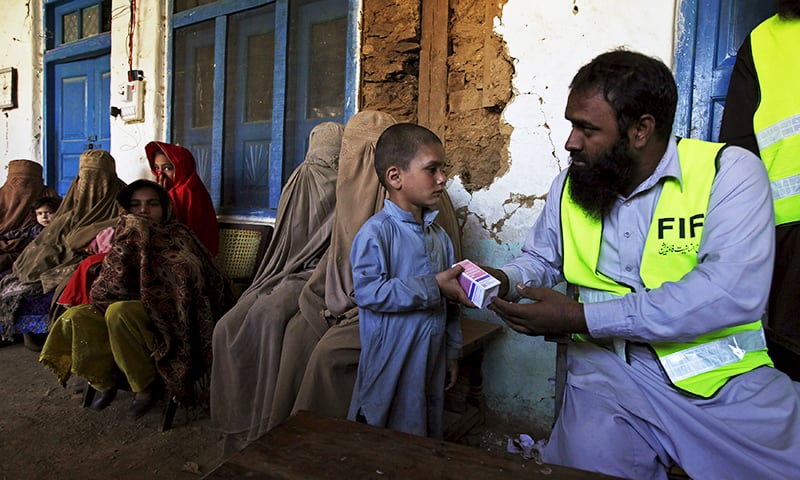 Volunteers distribute free medicine to people affected by the earthquake at a medical camp set up by the the Falah-e-Insaniat Foundation, a sister organisation of Jamaat-ud-Dawa,  in the Rehankot village in district Upper Dir, Pakistan, October 28, 2015.— Reuters