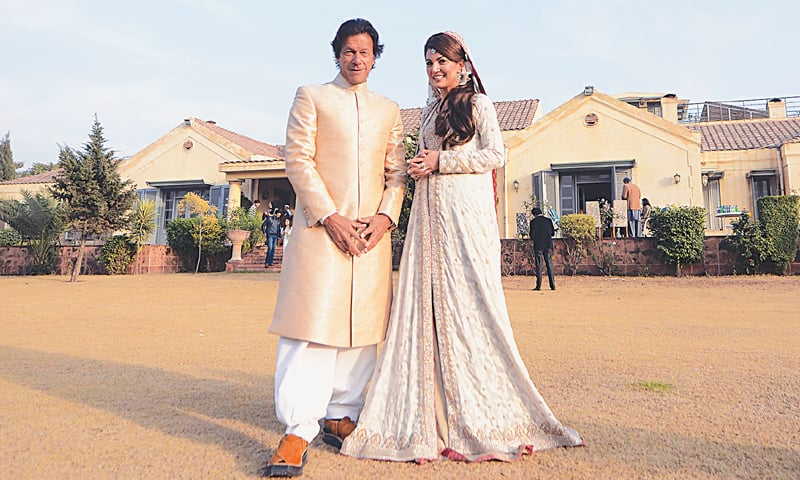 this handout photograph released by the Pakistan Tehreek-i-Insaf on Jan 8, 2015, shows Imran Khan and Reham Khan posing for a photograph at their wedding ceremony in Islamabad.—AFP