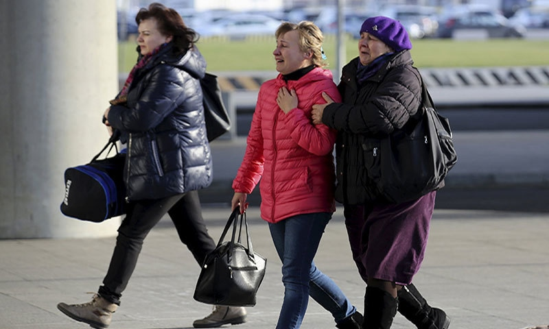 Women react as they walk at Pulkovo airport in St. Petersburg, Russia after the news of deadly crash─ Reuters