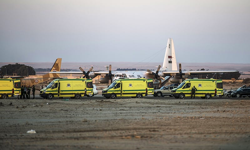 Egyptian ambulances carrying the corpses of Russian victims of a Russian passenger plane crash in the Sinai Peninsula, off load the bodies into a military aircraft at Kabret military air base. -AFP
