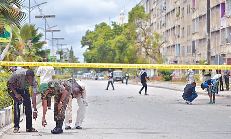 ZANZIBAR CITY: Military and police investigators collect evidence for forensic analysis at the site of the explosion.—AFP