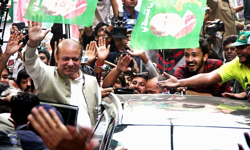 Prime Minister Nawaz Sharif waves to supporters after casting his vote at a polling station. ─ Online/File