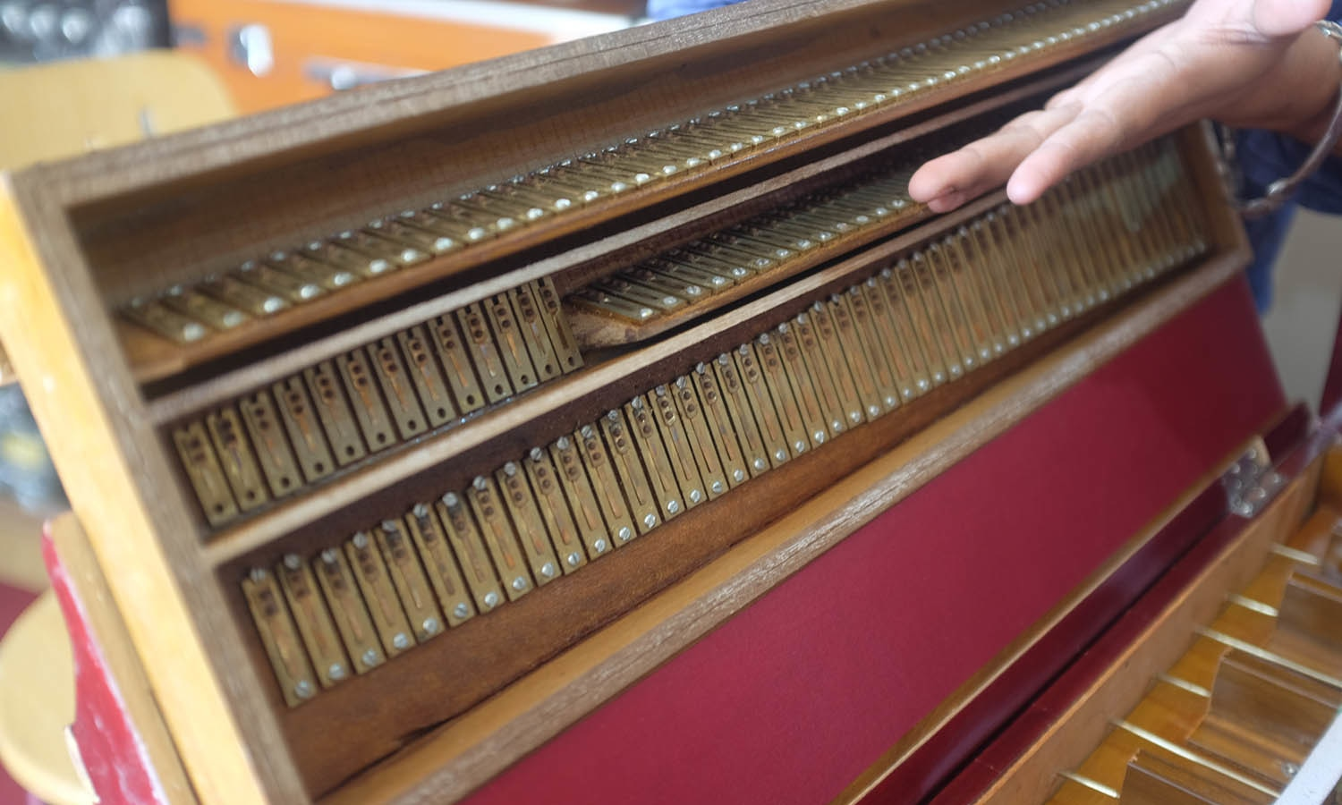 Waqar shows a delicate harmonium which was manufactured in Delhi.