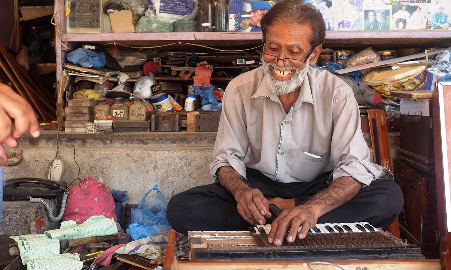 We finally locate Waheed's Music shop and find Waheed repairing a harmonium there.