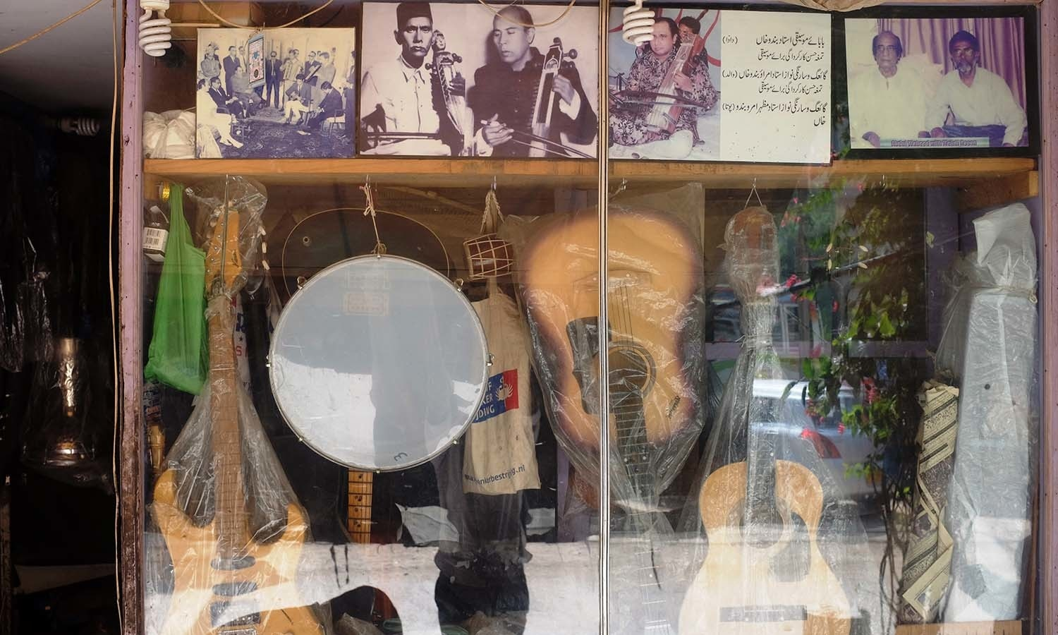 Waheed's photo with Mehdi Hassan is proudly displayed at the entrance.