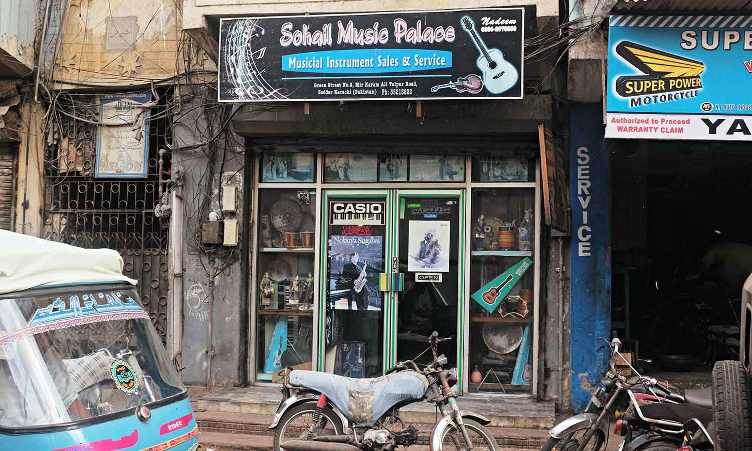 Sohail Music shop has a tiny entrance tucked between mechanic shops.