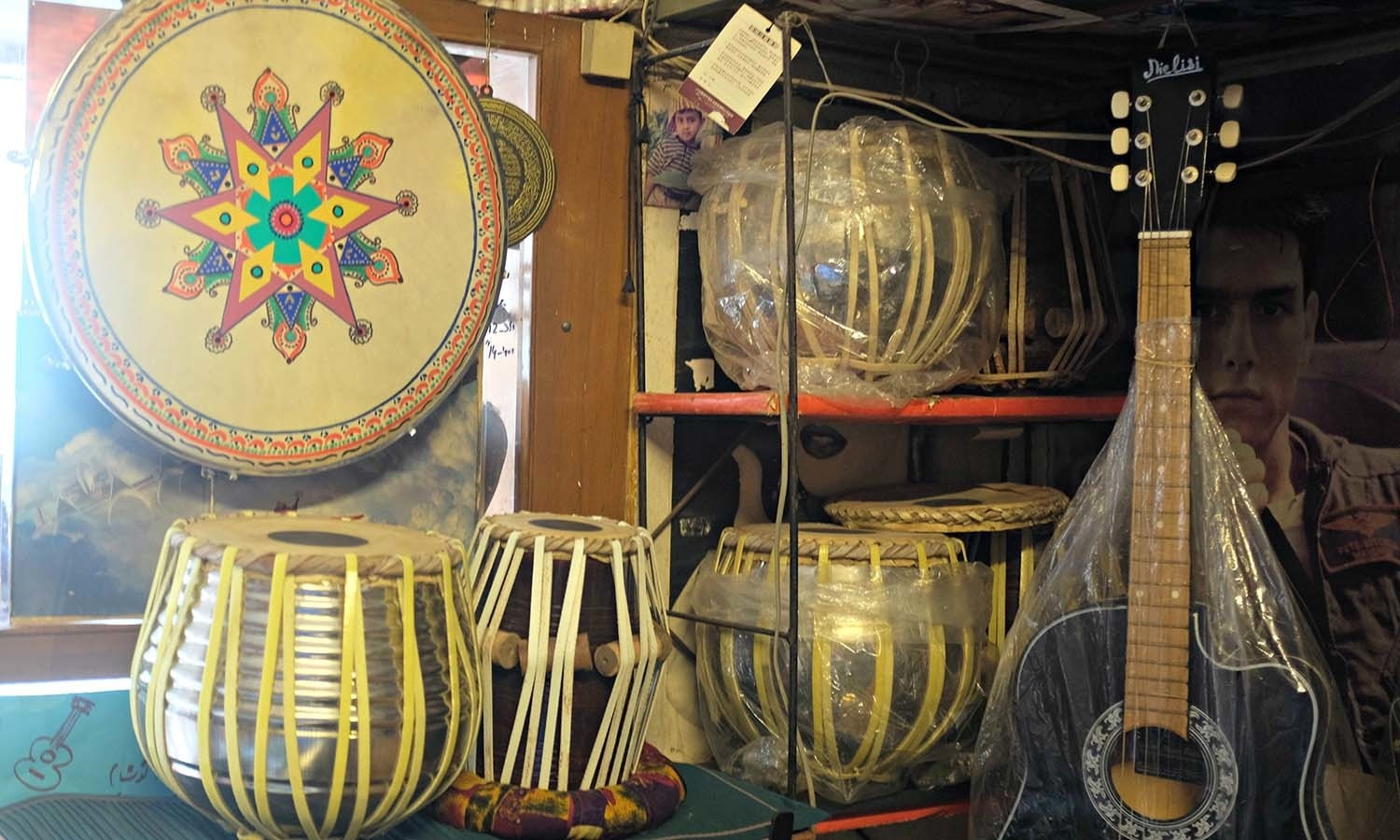 A beautiful display of decorated classical instruments at a music shop in Karachi.