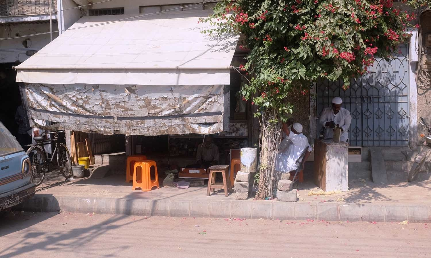 Waheed's music shop is tucked between a house and welding shop.