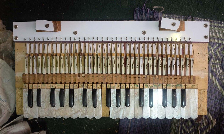 A harmonium undergoing repair.