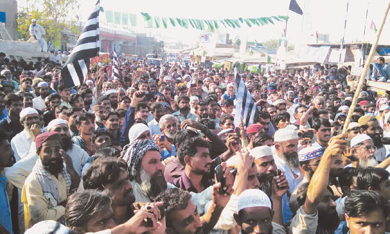 JUI-F activists and supporters fill a street in Tando Bago town of Badin district on Wednesday to protest against rigging and killings in the recently held face of the local government election in Sindh.—Dawn