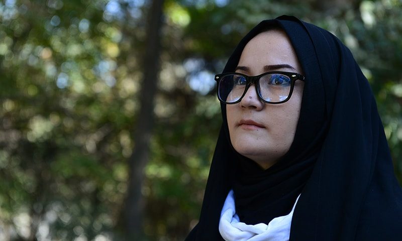 Afghan psychologist Fatima, 23, looks on during an interview with AFP at Wazir Akbar Khan Park in Kabul. — AFP