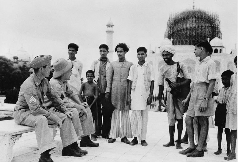British officers and locals outside the Taj. In the 1930s, the Taj was still being restored.