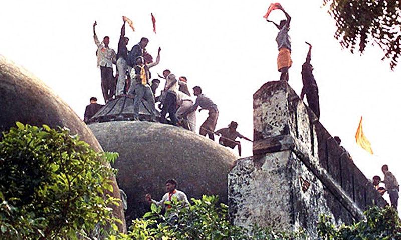 RSS activists demolishing Babri (1992).