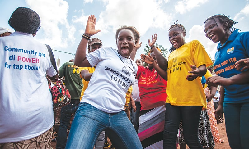 Freetown: Women celebrate after Sierra Leone was declared Ebola-free.—AP