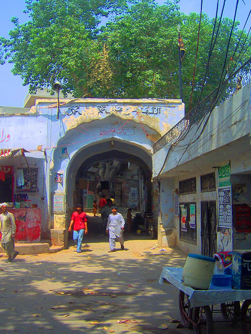 A historical gateway leading into the walled village of Niaz Baig.