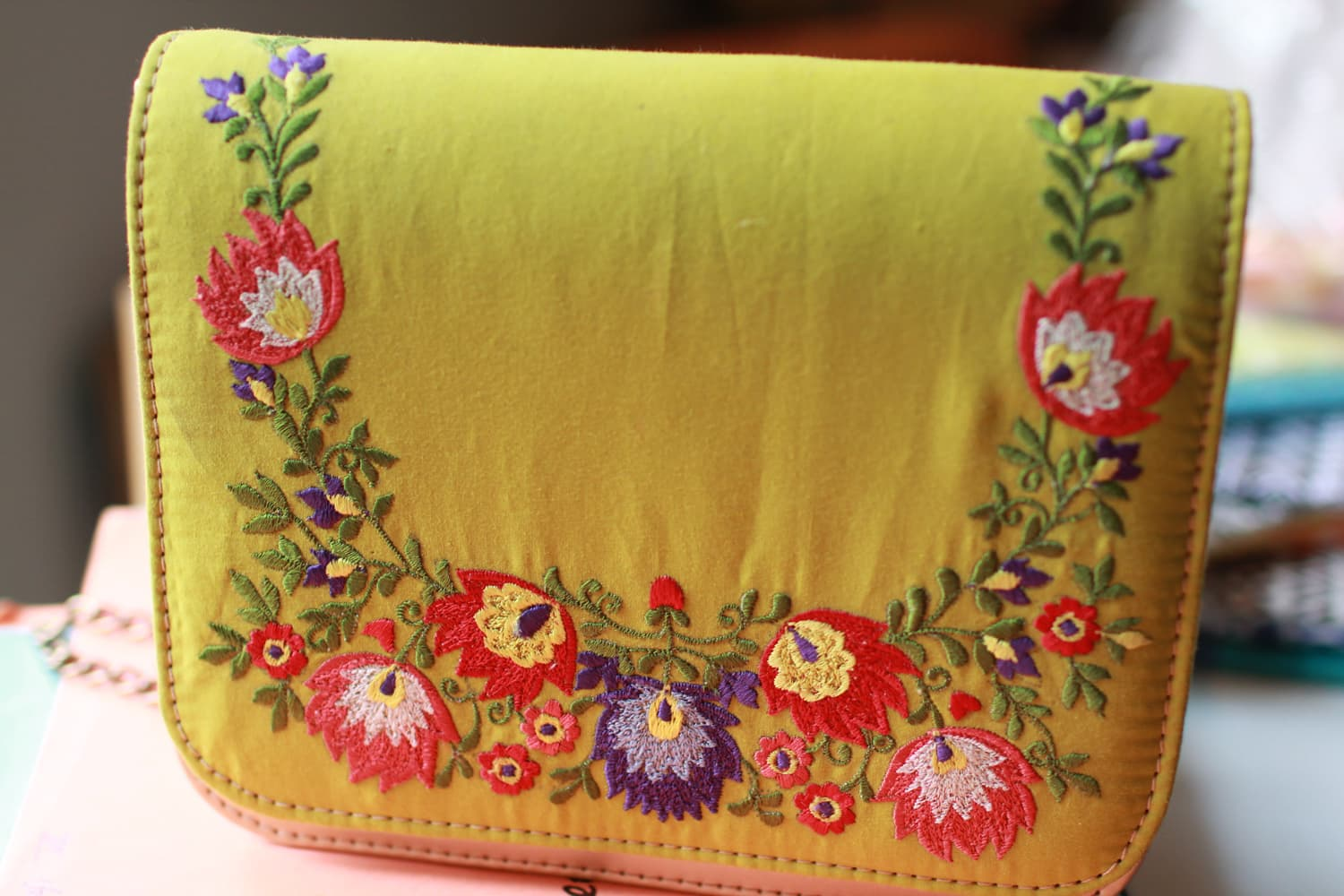 An embroidered bag made by the team.