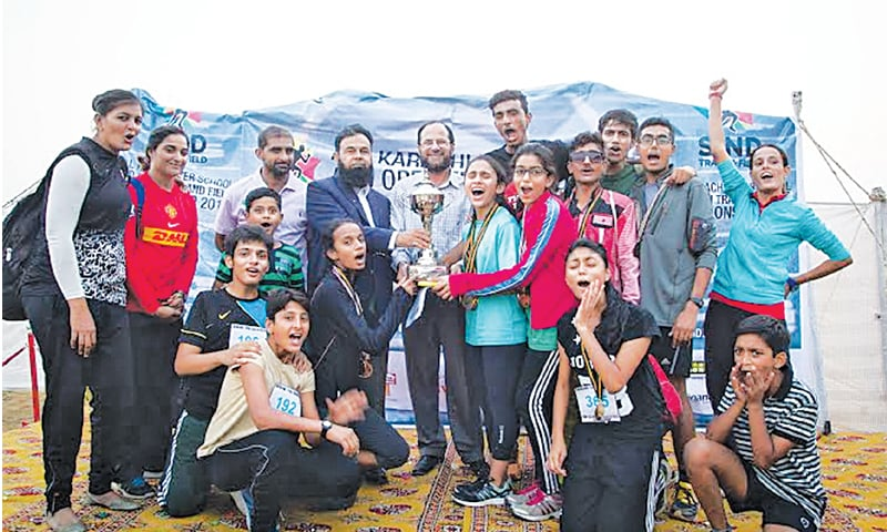KARACHI: Young athletes and winners pose for a group photo along with organisers after the Sindh Track and Field event at NCC.