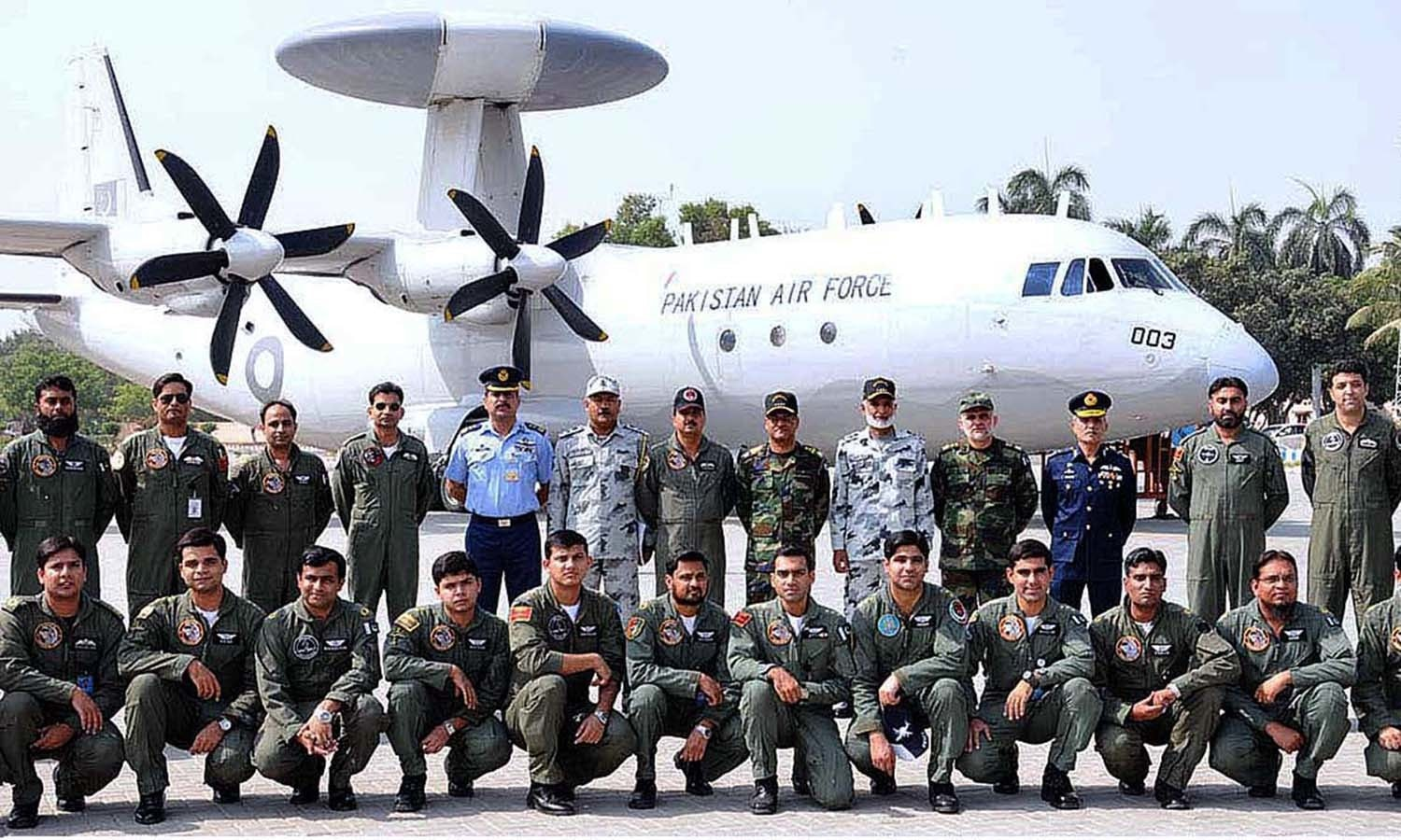 Chief of Naval Staff Admiral Muhammad Zakaullah and Air Chief Marshal Sohail Aman Chief of Air Staff, Pakistan Air Force, with the participating crew of the exercise Sea Spark. — APP