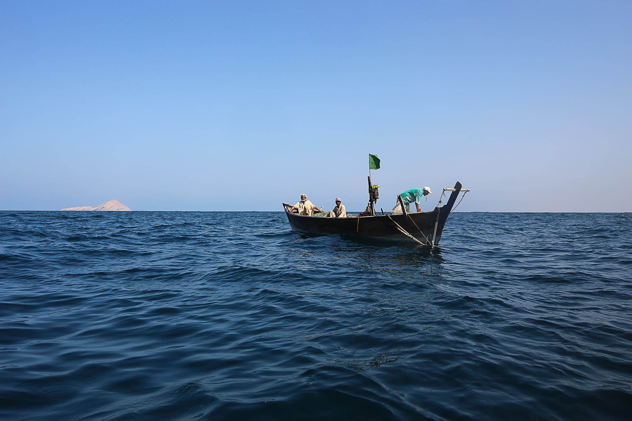 One of the other fishermen from the village passes us as they head out to the location of their nets.